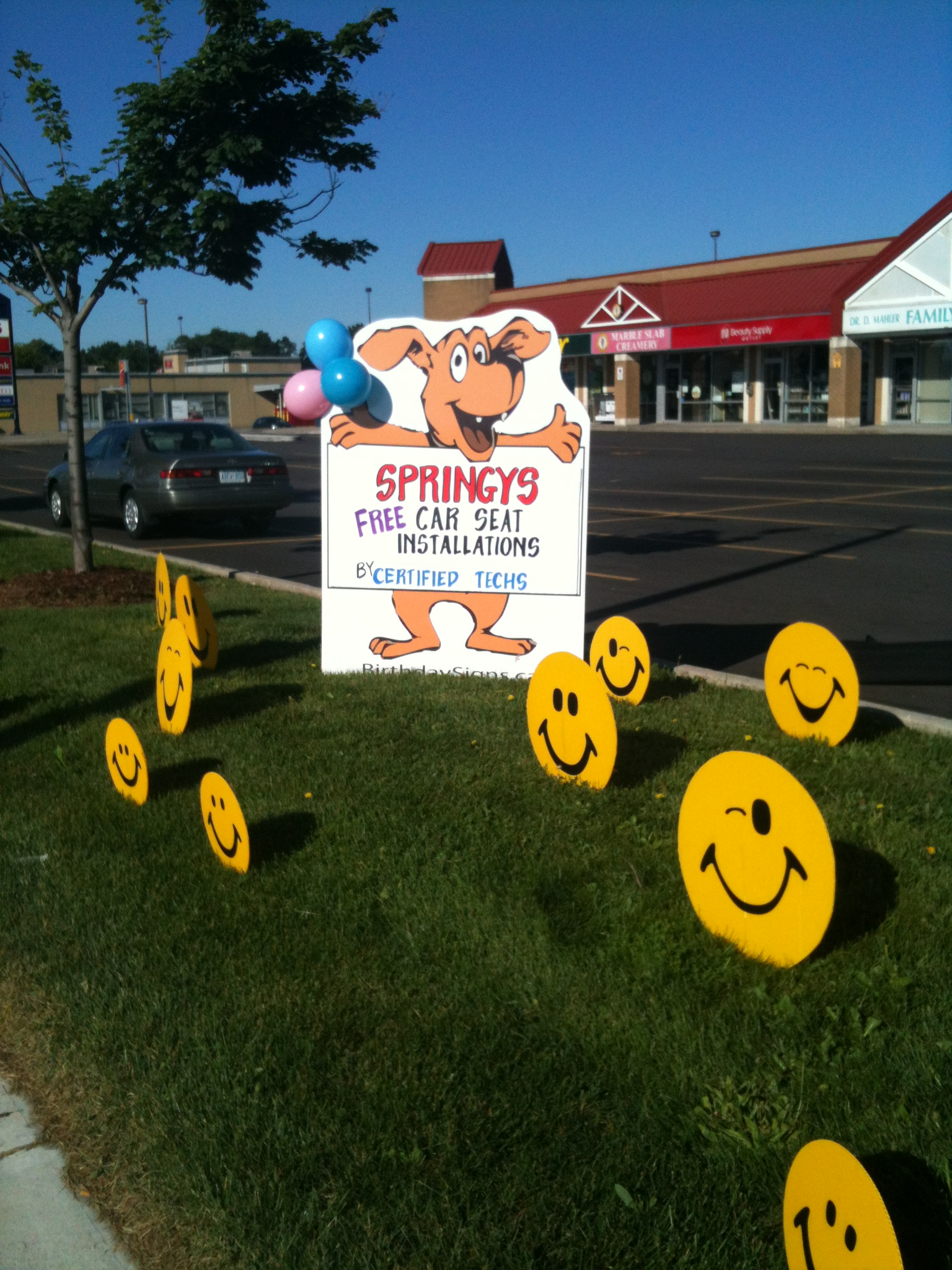 Giant Dog sign for a Store event with Smiley faces